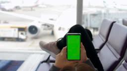 Departure lounge using phone,Green screen