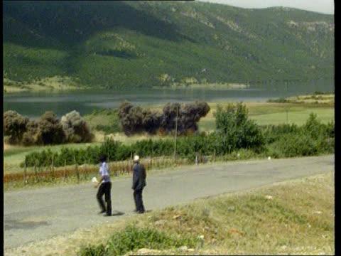 Report refutes health risk LIB YUGOSLAVIA Serbia Kosovo TGV Village PAN explosion in field as men on road