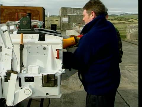 Depleted uranium testing resumes ITN Solway Firth Dundrennan Large artillery gun as firing depleted uranium shell during testing SOT SIDE TCMS Man's...