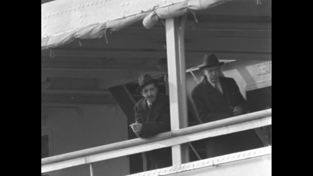 deposed spanish king alfonso xiii stands at rail of ship with man as he departs naples / alfonso wearing beret on deck with another man / note exact... - emigration and immigration stock videos & royalty-free footage
