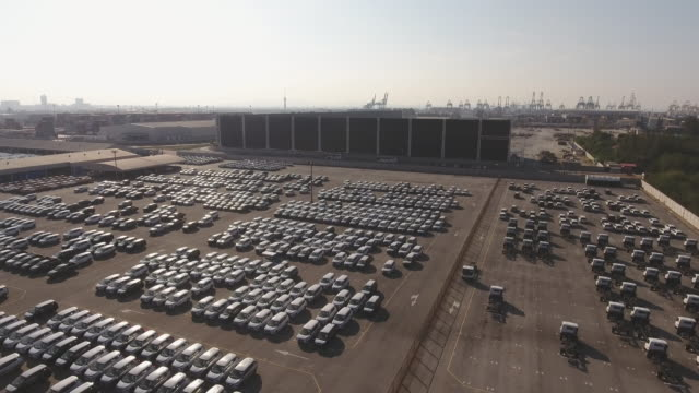 depot of new cars ready to be distributed stock video, aerial view - abundance stock videos & royalty-free footage
