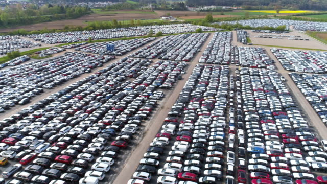 depot of new cars ready to be distributed - automobile industry video stock e b–roll
