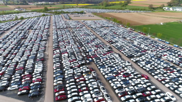 depot of new cars ready to be distributed - car park stock videos & royalty-free footage