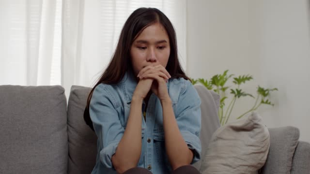 depressed attractive young woman looking thoughtful about troubles. - grief stock videos & royalty-free footage