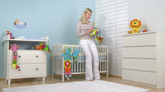 hd dolly: depressed mother in the nursery - postpartum depression stock videos & royalty-free footage