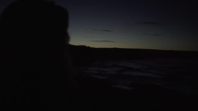 depressed sad woman coast sunset hat dark sea seaside evening night dusk sunset