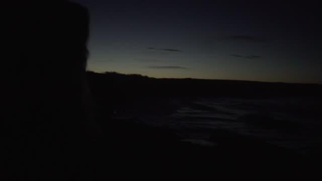 depressed sad woman coast sunset hat dark sea seaside evening night dusk sunset - depression land feature stock videos & royalty-free footage