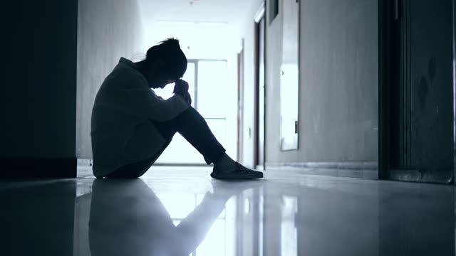 depressed teenage girls sitting on corridor ground - terrified stock videos & royalty-free footage