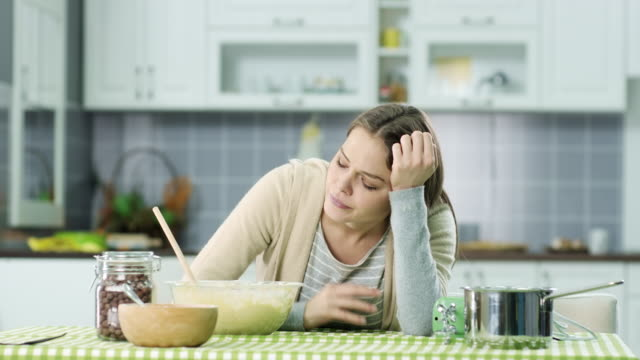 depressed woman in the kitchen - frustration stock videos & royalty-free footage