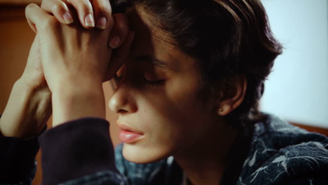 depressed young woman feeling headache. - tristezza video stock e b–roll