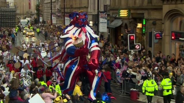 Depression when adjusting to life after a top class sporting career LIB / Float with large lion in the colours of the Union Jack flag holding an...