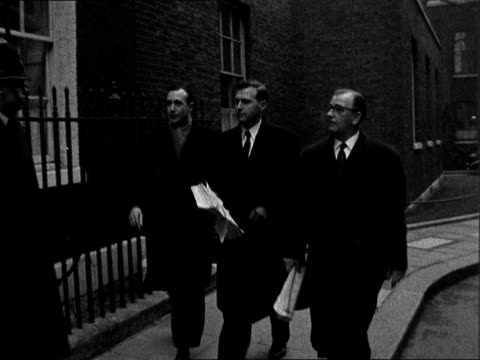 stockvideo's en b-roll-footage met deputation on colonial freedom:; england: london: downing street: no 10: ext three men towards in downing. street, they are from left to right: mr.... - itv evening bulletin