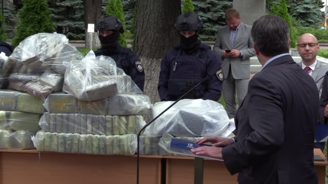 Deputy Chief Regional Officer for the United States Department of the Drug Enforcement Administration Kevin Daniels speaks standing next to bags of...