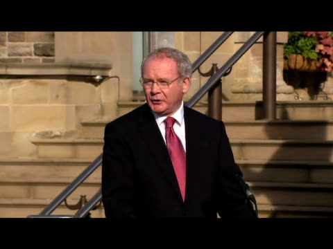 deputy first minister martin mcguinness talks to press following cabinet meeting with us secretary of state hillary clinton and first minister peter... - stormont stock videos and b-roll footage