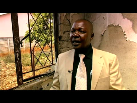deputy mayor of harare emmanuel chiroto comments on possibility of forgiving violent opposition gangs who killed his wife in house fire 30 july 2009 - harare stock videos and b-roll footage