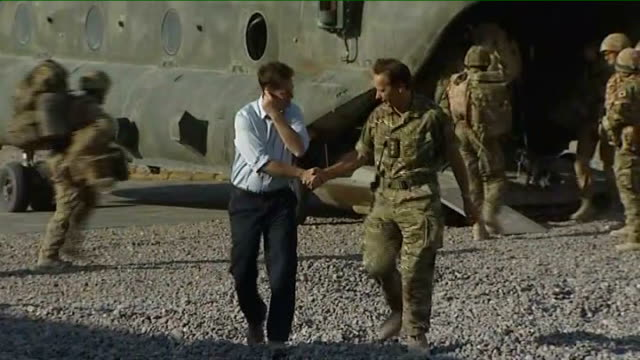 deputy prime minister nick clegg visits troops; afghanistan: helmand: ext deputy prime minister nick clegg mp along in shirt sleeves from helicopter... - vest stock videos & royalty-free footage