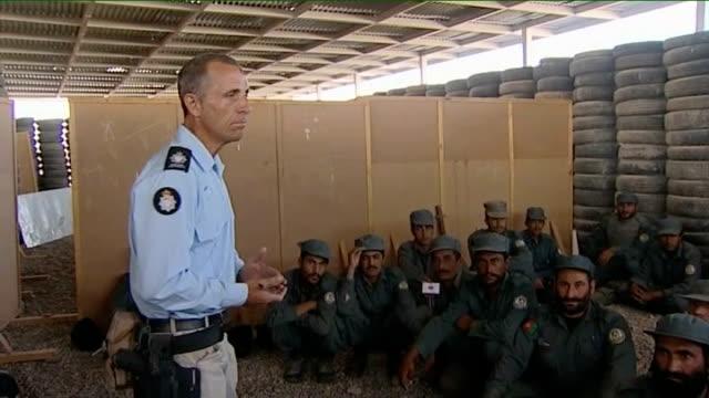 vídeos y material grabado en eventos de stock de deputy prime minister nick clegg visits troops; member of ministry of defence police addressing afghan police recruits on importance of honesty and... - military recruit