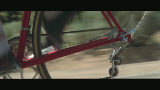 cu pov derailleur shifting gears on red racing bicycle - pedal stock videos & royalty-free footage