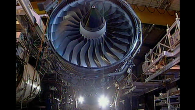 rollsroyce jet engine lifted along thru factory - rolls royce stock videos & royalty-free footage