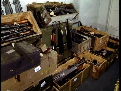 derbyshire: gvs greenwoods' farmhouse int cache of weapons recovered from greenwoods' farmhouse - ダービーシャー点の映像素材/bロール