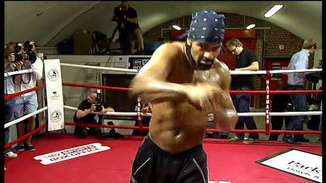 dereck chisora and david haye could face ban following brawl; england: 14.6.2011 / r14061109 david haye training in boxing ring - 後を追う点の映像素材/bロール