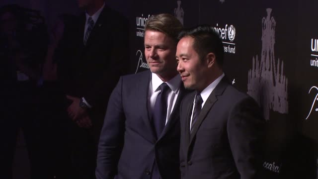 derek lam and guest at the ninth annual unicef snowflake ball at cipriani, wall street on in new york city. - cipriani manhattan stock videos & royalty-free footage