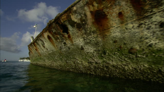 derelict ships rust in the water. - imperfection stock videos & royalty-free footage