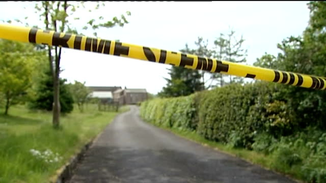 inquest t03061006 lamplugh police tape cordon across road leading to home of david bird - derrick bird cumbria stock-videos und b-roll-filmmaterial
