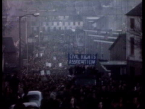 derry protestors gunfire sot from line of soldiers gv civil rights rally soldiers running towards past armoured vehicles towards past - derry northern ireland stock videos & royalty-free footage
