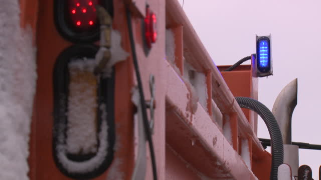 des moines, ia, u.s. - close-up of emergency lights of a snow plow during a period of heavy snowfall on tuesday, january 26, 2021. a total of 12.6... - blinking stock videos & royalty-free footage