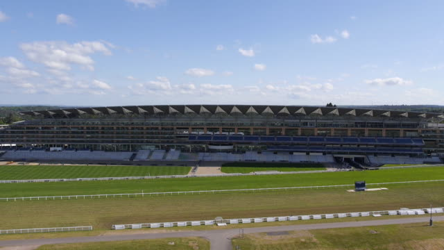 descending aerial view of the new grandstand and royal box at ascot racecourse - captured by a licensed uav operator with pfaw - イギリス アスコット競馬場点の映像素材/bロール