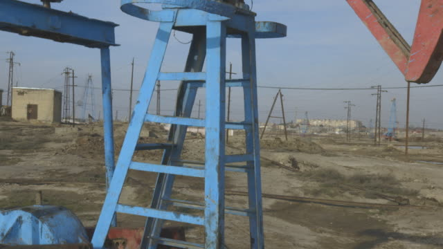 descending crane shot, moving over an operational pumpjack. - baku video stock e b–roll