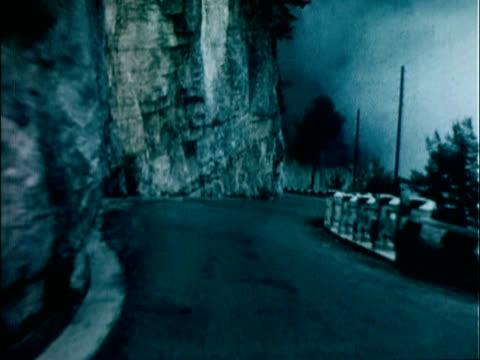 1959 ws pov descending down winding french alps road / united kingdom - felswand stock-videos und b-roll-filmmaterial