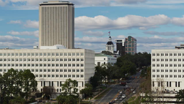 descending drone of the state capitol complex in tallahassee, florida - florida us state stock videos & royalty-free footage
