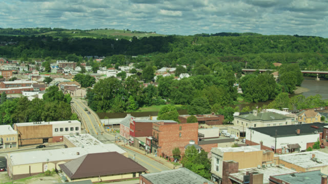 descending drone shot of connellsville, pennyslvania - street name sign stock videos & royalty-free footage