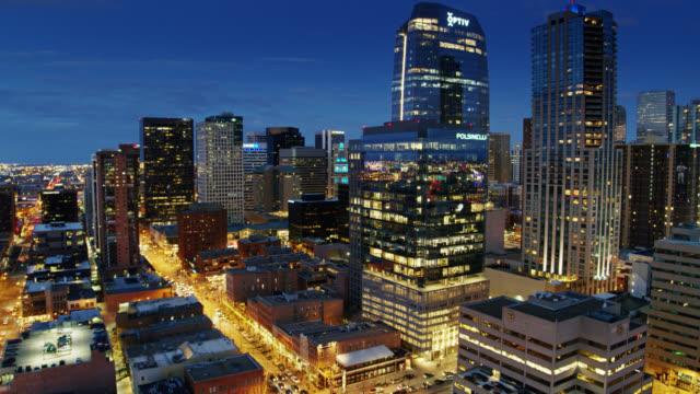 descending drone shot of downtown denver at night - denver stock videos & royalty-free footage