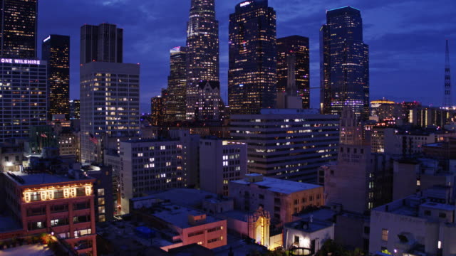 descending drone shot of downtown los angeles at night - urban road stock videos & royalty-free footage