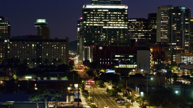 descending drone shot of downtown phoenix at nightfall - phoenix arizona stock videos & royalty-free footage