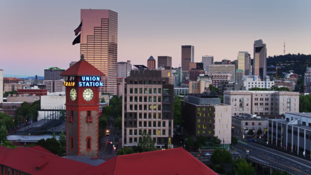 descending drone shot of downtown portland approaching union station clock tower - portland oregon street stock videos & royalty-free footage