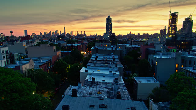 descending drone shot of greenpoint, brooklyn at dusk - brooklyn new york stock videos & royalty-free footage