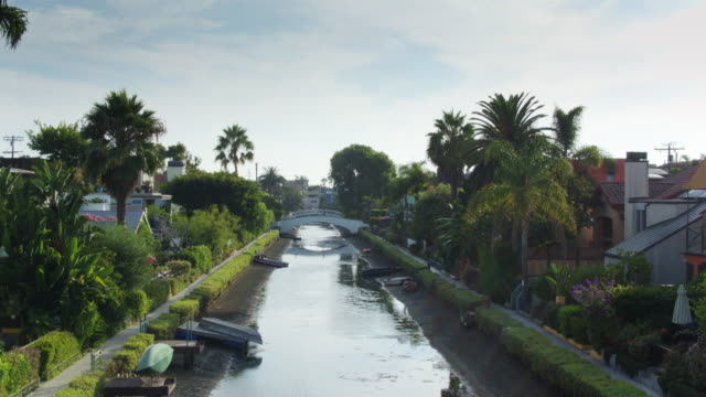 descending drone shot of lovely houses along the canals in venice, california - canal stock videos & royalty-free footage