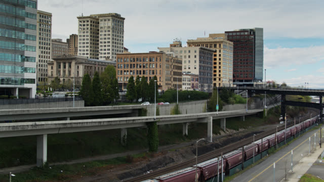 descending drone shot of roads and railways on the edge of downtown tacoma - pierce county washington state stock videos & royalty-free footage