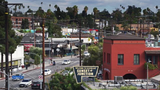 descending drone shot of sunset junction, los angeles - santa monica blvd stock videos & royalty-free footage