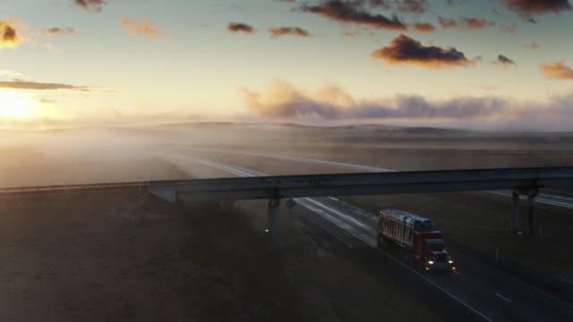 descending drone shot of truck on freeway on foggy morning - interstate 10 stock videos & royalty-free footage