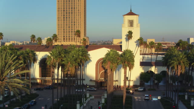 descending drone shot of union station, los angeles at sunset - union station los angeles stock videos & royalty-free footage