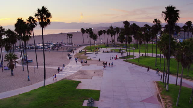 descending drone shot of venice beach skate park at sunset - venice california stock videos & royalty-free footage