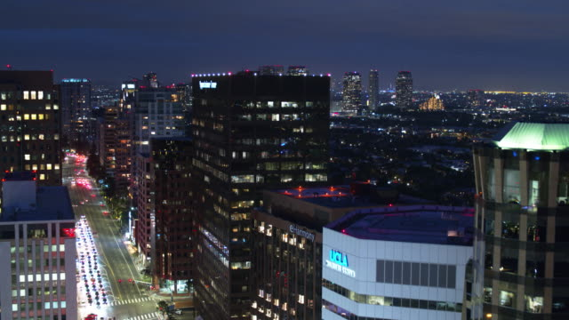 descending drone shot of wilshire blvd, los angeles at night - westwood neighborhood los angeles stock videos & royalty-free footage