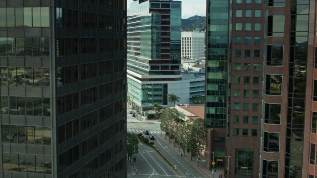 descending drone shot revealing westwood blvd, los angeles between condo towers - westwood neighborhood los angeles stock videos & royalty-free footage