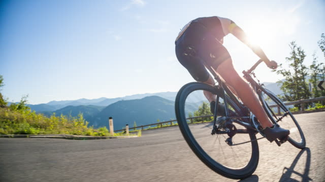 descending on a road bike - bicycle stock videos & royalty-free footage