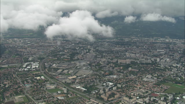 descending past clouds to grenoble - grenoble stock-videos und b-roll-filmmaterial